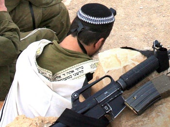 A religious IDF soldier praying