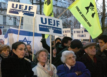 French Jews at a protest in Paris in 2003.Some of the men are wearing kippot, others hats and some are bareheaded.