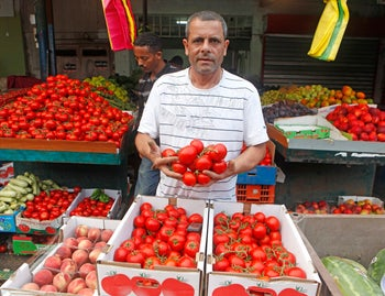 A tomato vendor at Shuk HaCarmel.