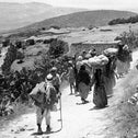 Palestinian refugees returning to their village after its surrender during the 1948 Arab-Israeli war.