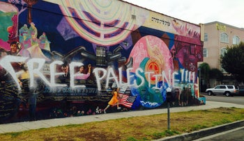 A mural on the side of the Southern California campus defaced with graffiti.