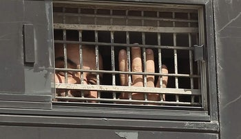 A Palestinian terrorist is seen behind bars, on the eve of his being released.