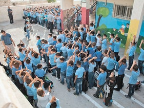 An elementary school in Abu Tor in Arab East Jerusalem. The balconies have been converted into classrooms.