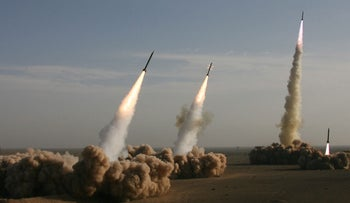Iran's Revolutionary Guards fire longer-range missiles with a range of up to 2,000 km in the central desert outside the holy city of Qom during a military maneuver