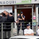 Sarcelles Mayor Francois Pupponi, left facing, and Rabbi Chalom Berros, right, in front of the kosher store where a bomb exploded in Sarcelles, north of Paris, Wednesday, Sept. 19, 2012.