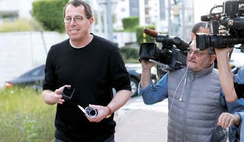 Boaz Harpaz outside his home when he was in the media spotlight in 2014 during the so-called Harpaz affair.