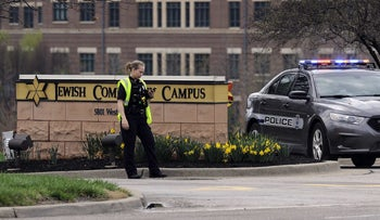 A police officer from Overland Park, Kansas, guarding the entrance to the scene of a shooting at the Jewish Community Center of Greater Kansas City, April 13, 2014.