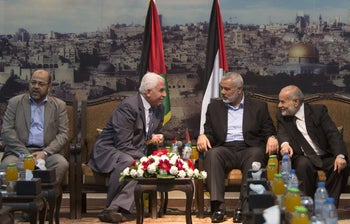 Fatah and Hamas representatives meet in Gaza City, April 22, 2014.
