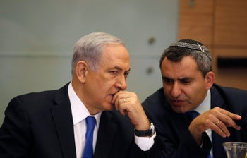 Prime Minister Benjamin Netanyahu listens to MK Zeev Elkin during a meeting of the Knesset Foreign Affairs and Defense Committee  in Jerusalem.