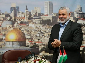 Senior Hamas leader Ismail Haniyeh gestures before delivering a farewell speech for his former position as a Hamas government prime minister, Gaza City, June 2, 2014.