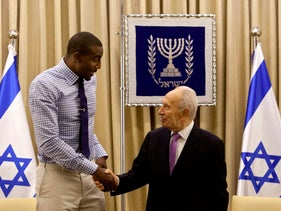 U.S. NBA's New York Knicks basketball player Amare Stoudemire, shakes hands with Israel's President