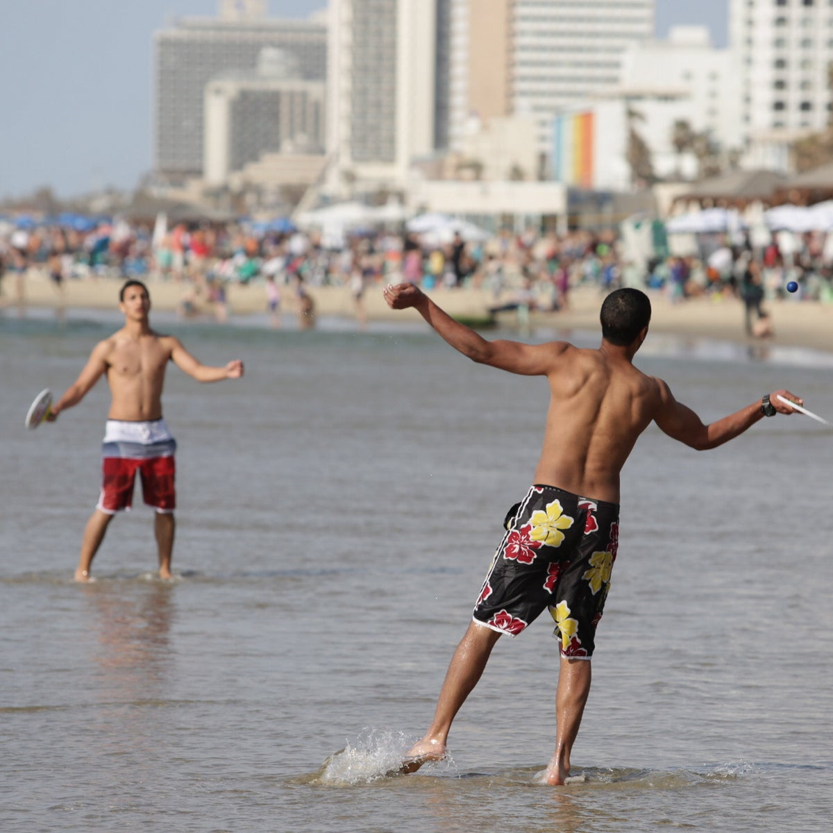 Israelis playing matkot on the beach in Tel Aviv., March 17, 2015.