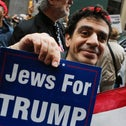 """A supporter of Donald Trump, holding a sign that reads """"Jews for Trump,"""" stand outside Trump Tower in New York, October 8, 2016."""