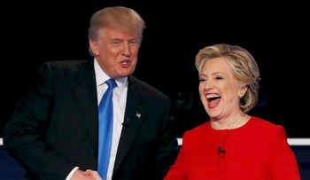 Republican nominee Donald Trump shakes hands with Democratic nominee Hillary Clinton at the conclusion of their first presidential debate at Hofstra University in Hempstead, New York, U.S., Sept. 26, 2016.