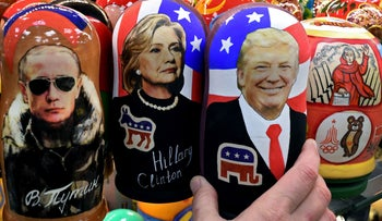 Traditional Russian wooden nesting dolls, Matryoshka dolls, depicting Russia's President Vladimir Putin, US Democratic presidential nominee Hillary Clinton and US Republican presidential nominee Donald Trump are seen on sale at a gift shop in central Moscow on November 8, 2016.
