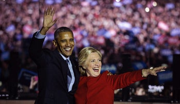 Hillary Clinton and U.S. President Barack Obama wave to the crowd during a campaign event prior to Election Day, Philadelphia, Pennsylvania, U.S., November 7, 2016.