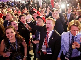 People cheer as voting results for Florida come in at Republican presidential nominee Donald Trump's election night event at the New York Hilton Midtown on November 8, 2016 in New York City.