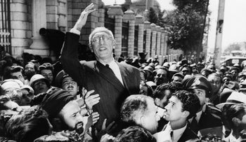 File photo: Prime Minister Mohammed Mosaddegh rides on the shoulders of cheering crowds in Tehran's Majlis Square after reiterating his oil nationalization views to supporters. Sept. 27, 1951.
