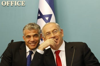 Former Finance Minister Yair Lapid and Prime Minister Benjamin Netanyahu.
