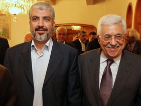 Palestinian President Mahmoud Abbas  and Hamas' political chief Khaled Meshal are seen together during their meeting in Cairo, Egypt, Thursday, Nov. 24, 2011.