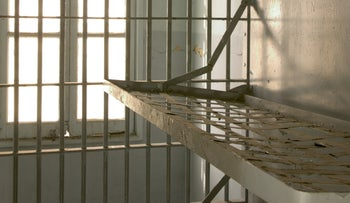 A view of the inside of an empty prison cell.