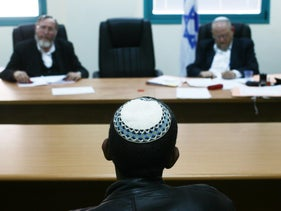 A candidate for conversion sits before a special conversion court in Jerusalem.