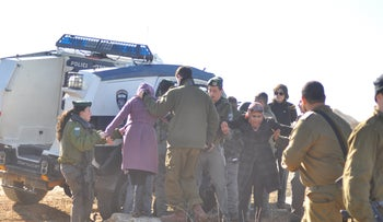 IDF forces arresting Ta'ayush activists in the South Hebron Hills.