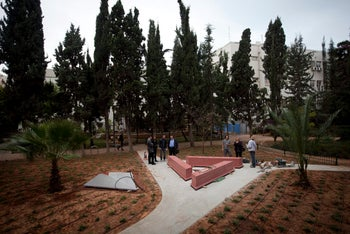 Workers building the memorial to gay Holocaust victims at Gan Meir, Tel Aviv