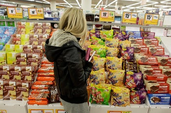 A shopper in Super-Sol takes her pick of chocolates.