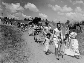 Palestinian refugees leaving a village near Haifa, June 1948.