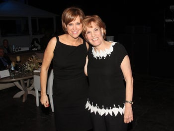 Bank Leumi CEO Rakefet Russak-Aminoach, left, and her former boss, Galia Maor. Banking is the only sector in which top female executives earn more than men.