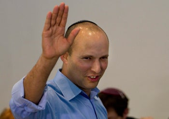 Education Minister Naftali Bennett, who is also Minister for Diaspora Affairs, waving.