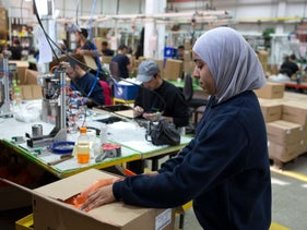 Palestinians had worked alongside Jews at the SodaStream factory: Mishor Adumim industrial park, Jan. 30, 2014, before the company had to move. The picture shows a female worker wearing blue clothing and a lilac headscarf, packaging.
