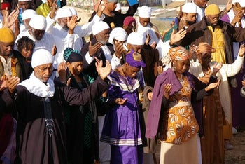 Members of the African Hebrew Israelite community pray during a Passover ceremony on a mountaintop in Dimona. March 2013
