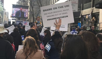 People gather outside the French Mission to the UN protesting against the Paris peace conference, January 12, 2017.