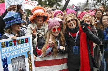 Gloria Steinem greets protesters at the barricades before speaking at the Women's March on Washington during the first full day of Donald Trump's presidency, Jan. 21, 2017 in Washington.