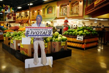 """A sign in Spanish which translates, """"Don't Lose Your Voice, Vote!"""" is displayed near a polling place in a Cardenas supermarket in Las Vegas on Friday, June 10, 2016."""