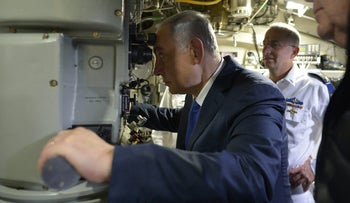 Prime Minister Benjamin Netanyahu onboard the Rahav, the fifth submarine in Israel's fleet, after it arrived in Haifa from Germany in January.