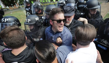 White nationalist Richard Spencer and his supporters clash with Virginia State Police in Lee Park after the 'United the Right' rally was declared unlawful August 12, 2017 in Charlottesville, Virginia.