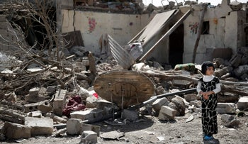 A girl stands on the rubble of a house destroyed by a Saudi-led airstrike in Sanaa, Yemen, Thursday, Feb. 25, 2016.