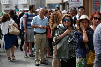 Israelis with French citizenship arrive at a polling station to vote for the French election in Tel Aviv, April 23, 2017.