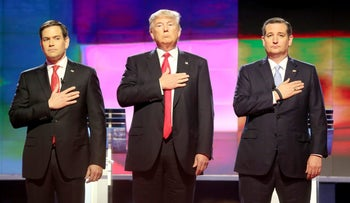 Republican presidential candidates Sen. Marco Rubio (left), Donald Trump and Sen. Ted Cruz stand up for the national anthem during a primary debate in Miami on Thursday, March 10, 2016.