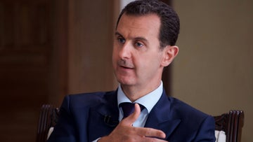 Syrian President Bashar Assad speaks during an interview with Australia's SBS news channel, Damascus, Syria, July 1, 2016.