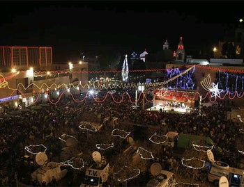 Thousands flock to Manger Square outside the Church of the Nativity, in the West Bank town of Bethlehem on December 24, 2010.