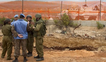 Israeli soldiers chat with UNIFIL peacekeepers along Israel's border with Lebanon, Metula, Israel, May 3, 2012.