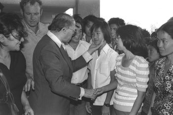 A different era for refugees in Israel: Then Prime Minister Menachem Begin greeting Vietnamese refugees in Afula in 1977.