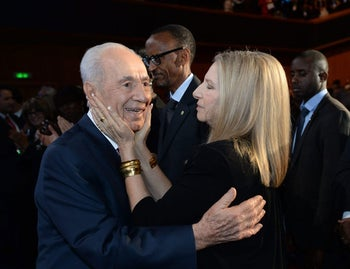 Until 120! Shimon Peres with Barbara Streisand after she sang two songs during his 90th birthday gala in Jerusalem, June 18, 2013.