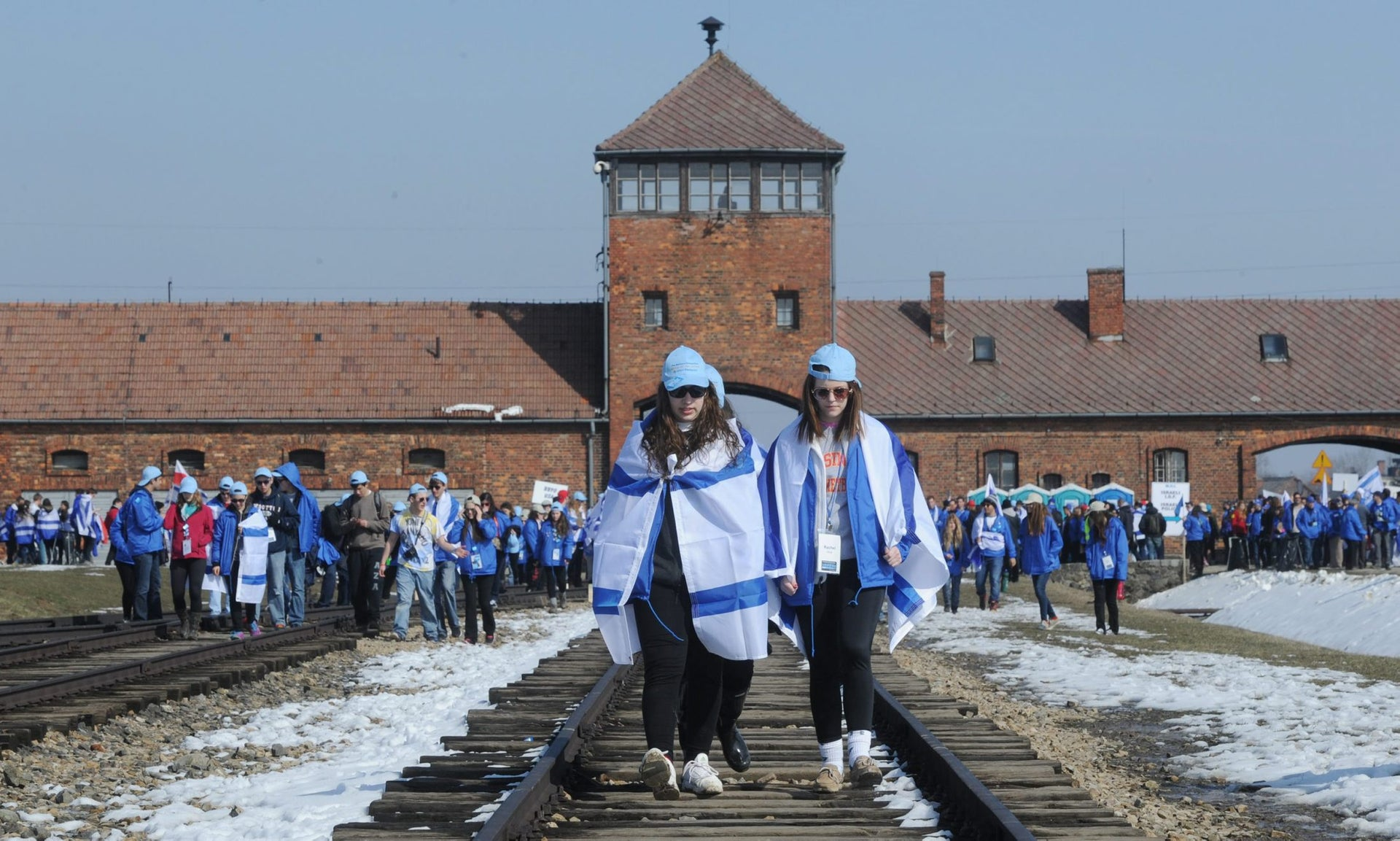 Participants of the March of the Living walk in the former Nazi Death Camp Auschwitz Birkenau, Poland, April 8, 2013.