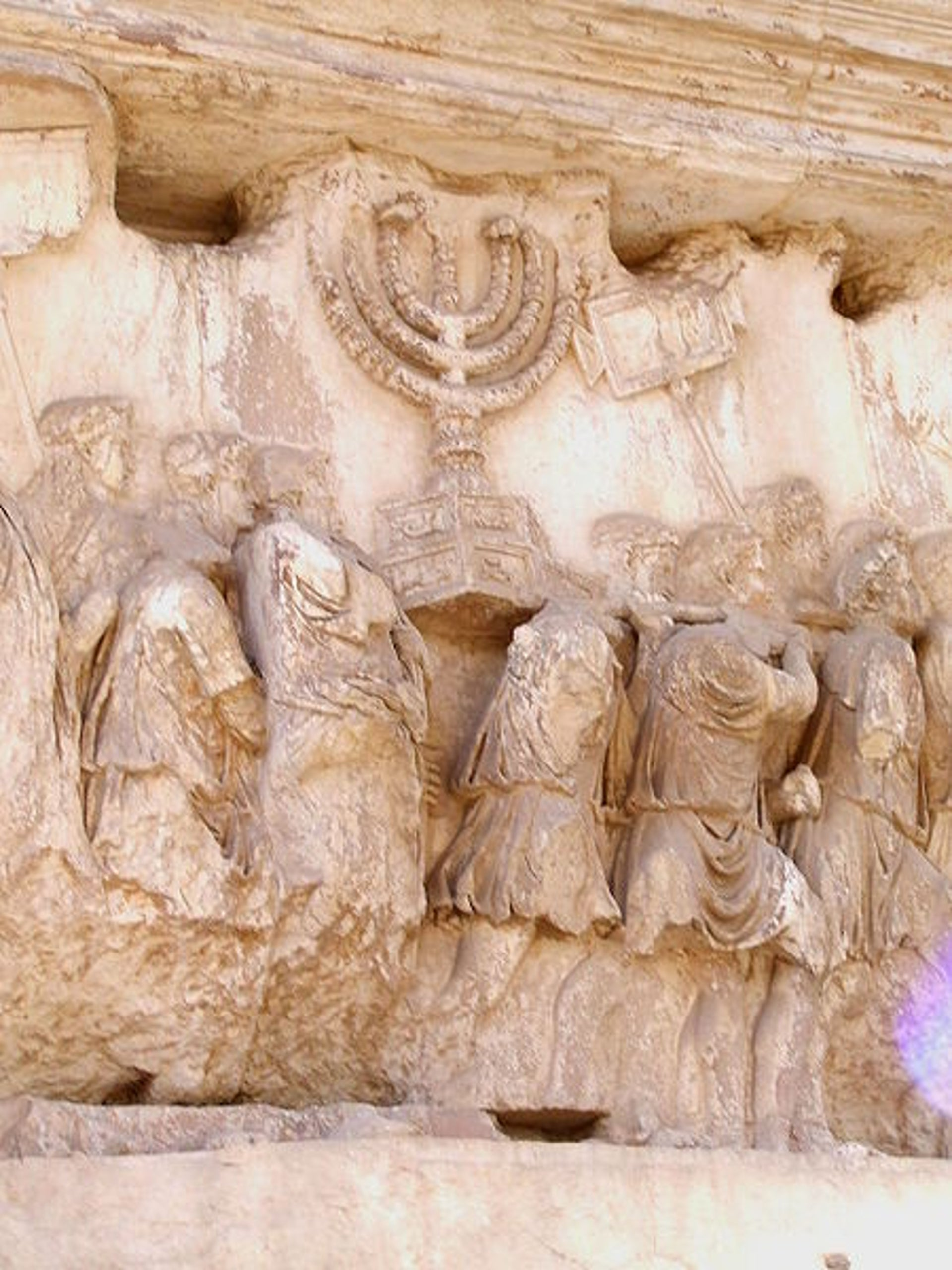 South panel of the Arch of Titus, Rome: The State of Israel adopted the Arch's depiction of the Temple Menorah, seen here, as its official state emblem in 1949. Emperor Titus had the arch made to commemorate destroying the Temple in Jerusalem and seizing its treasure, including the Menorah.