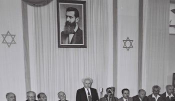 David Ben Gurion flanked by members of his provisional government reading the Declaration of the Establishment of the State of Israel, May 14, 1948.